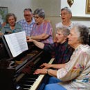 Playing the piano; Size=130 pixels wide